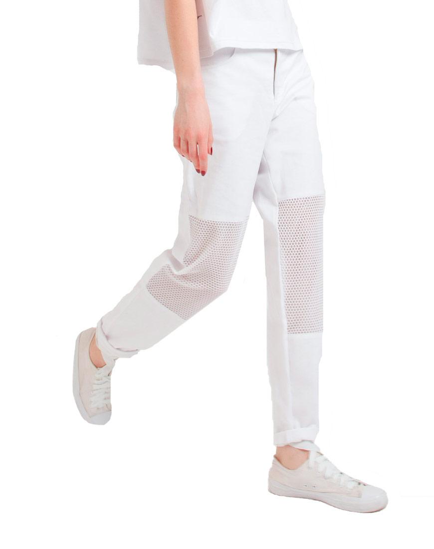 Свободные джинсы со вставками из сетки